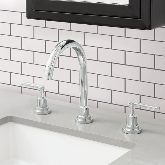 bathroom sink with peel and stick tiles