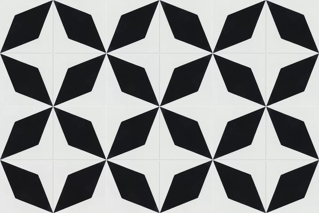 Black and white ceramic tile featuring abstract compass shapes