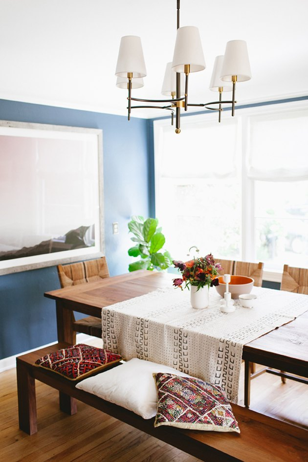 blue dining room with bench and dining chairs