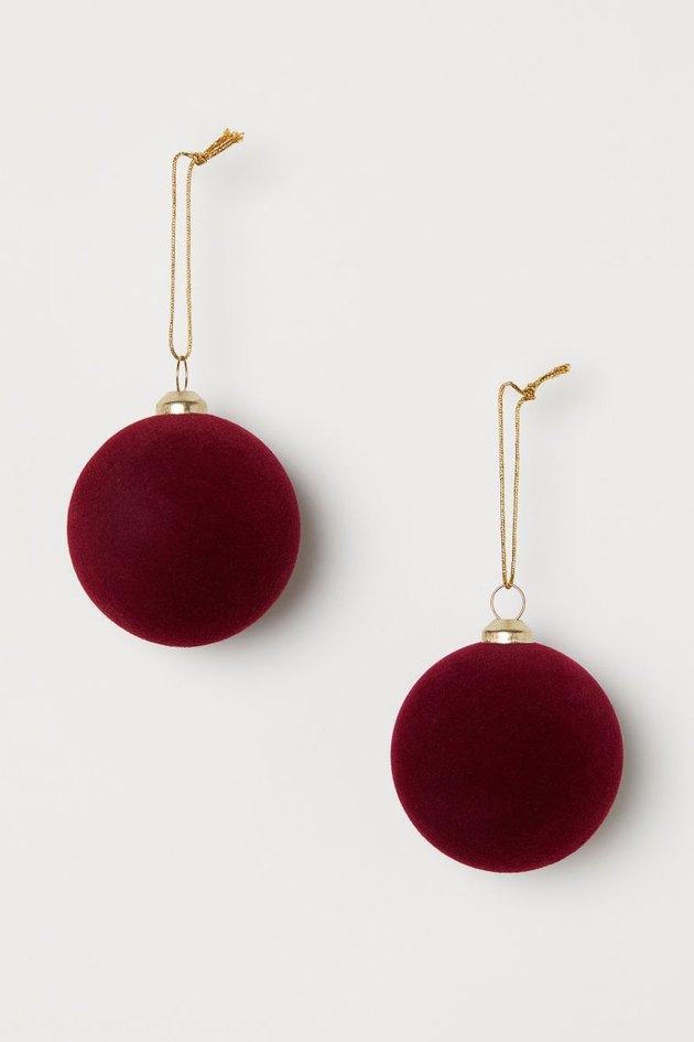 two velvet red christmas ornaments