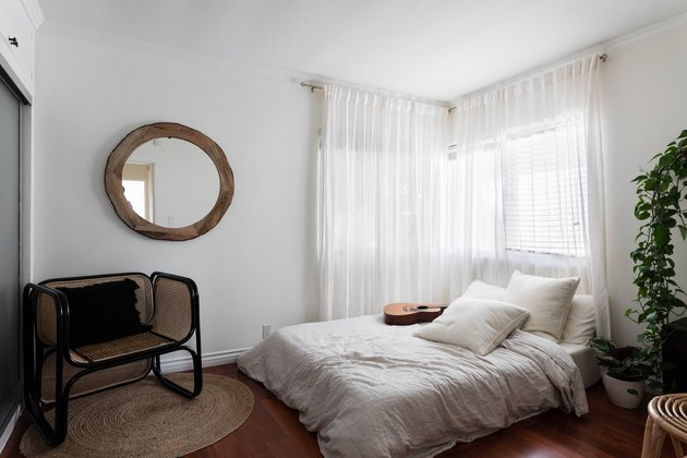 bedroom with low lying bed and hardwood floors