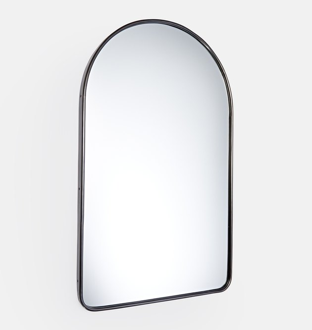 Arched wall mirror with thin black metal frame