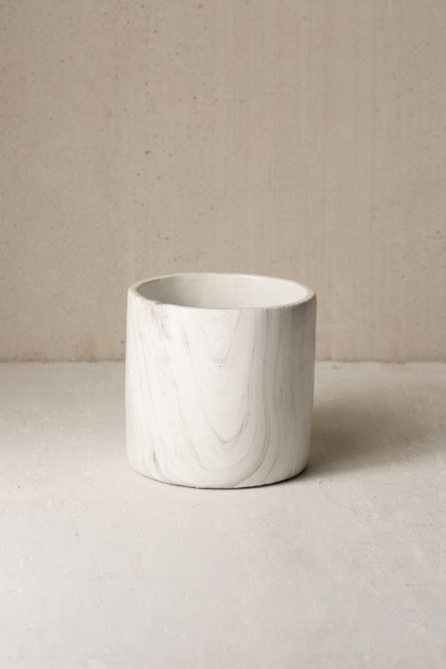 Small white circular marble-inspired planter