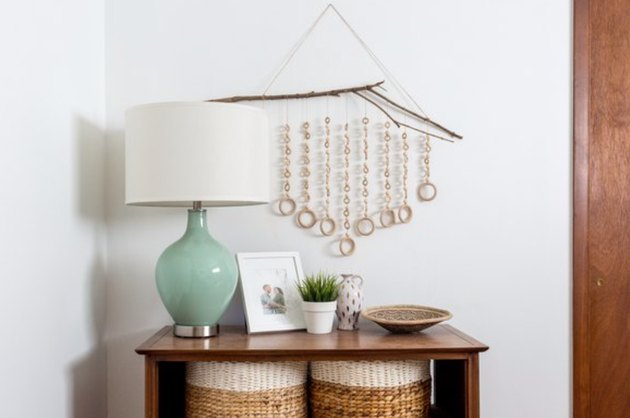 Mix and match pieces of wood to create this eclectic wall piece.