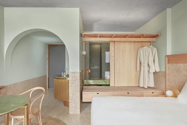 hotel room with green arches