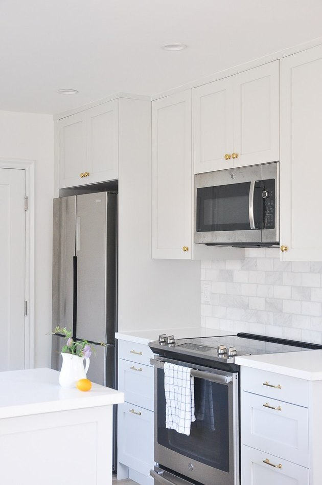 kitchen space with white and light gray cabinets