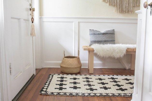 Boho-style enryway with jute rug and door tasel