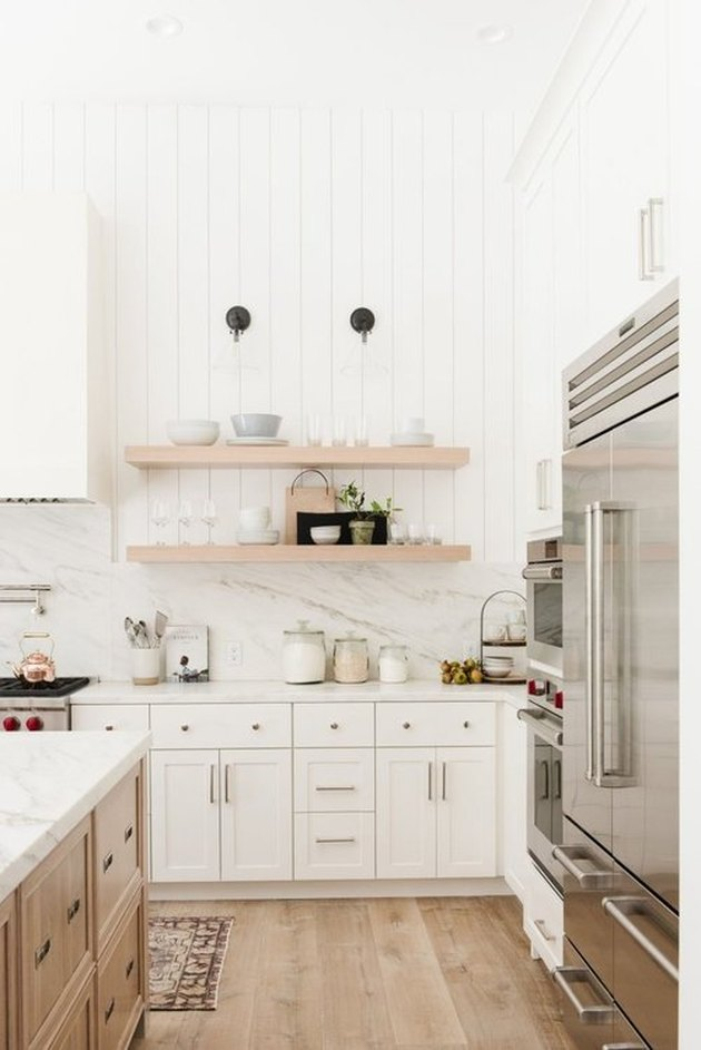 white kitchen with shiplap wall and open shelves