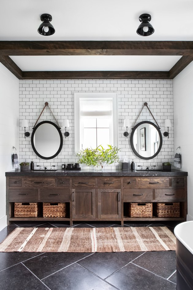 modern bathroom with oval hanging mirrors over double vanity