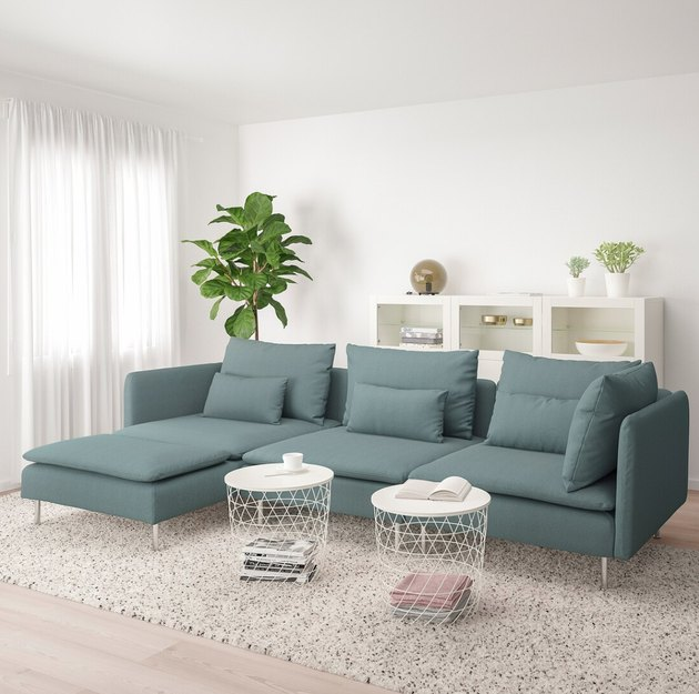 scandinavian-style living room with blue-green sofa