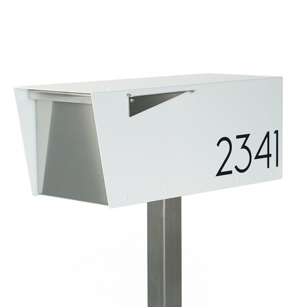White midcentury modern mailbox with angular details and black house numbers