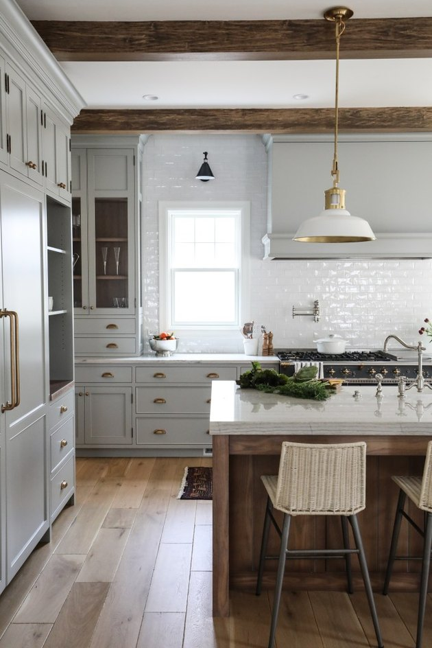 Gray kitchen color idea with transitional accents and brass pendant lights