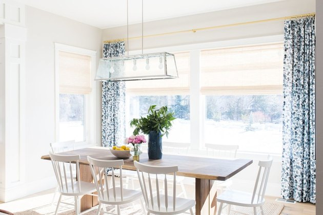 farmhouse-style dining room with blue floral curtains