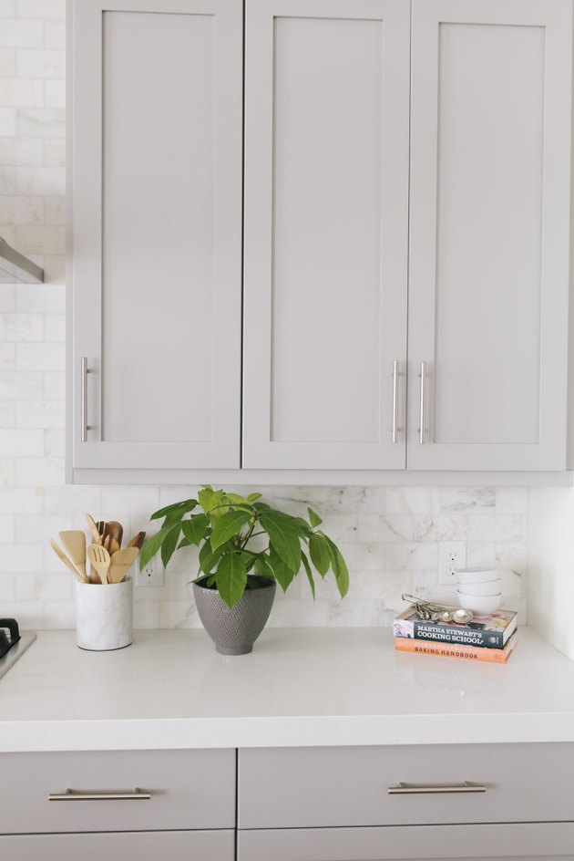 Gray kitchen color idea with gray cabinets and marble backsplash
