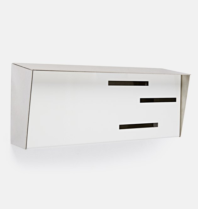 Wall-mounted midcentury modern mailbox with decorative slots in white
