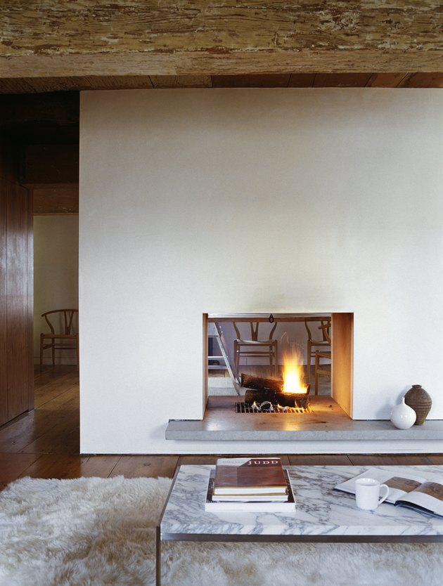 Cozy double-sided fireplace in a countryside cottage