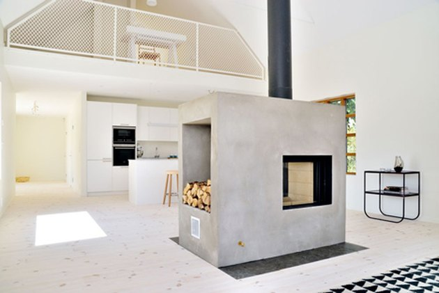 concrete chimney with double-sided wood-burning stove