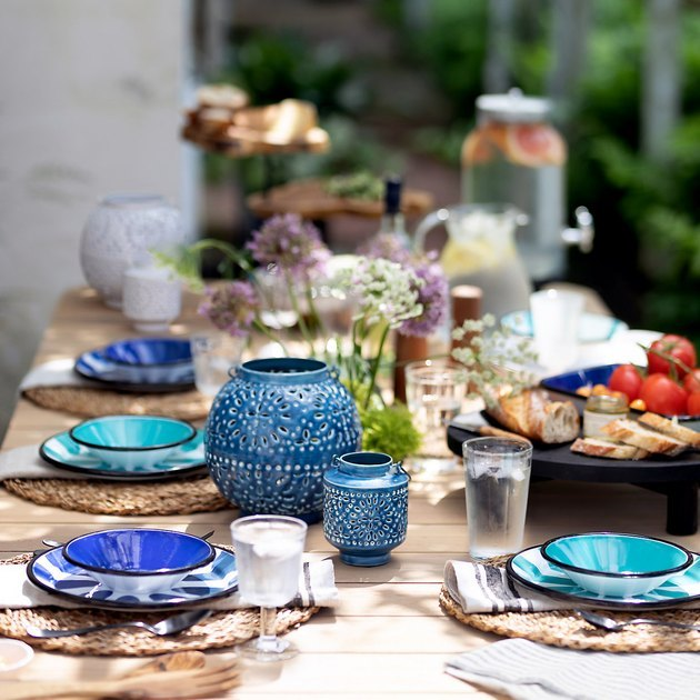 outdoor party idea with colorful dishware and decor