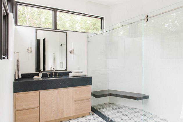 modern bathroom with black countertops