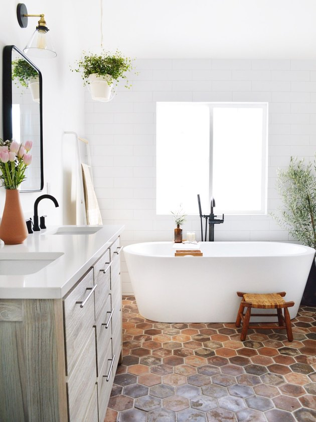 white bathroom with shiplap walls and brick floors