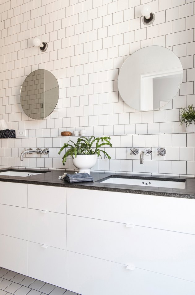 white bathroom with black countertops