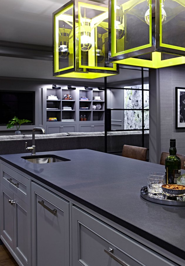 monochromatic basement kitchen with yellow lights