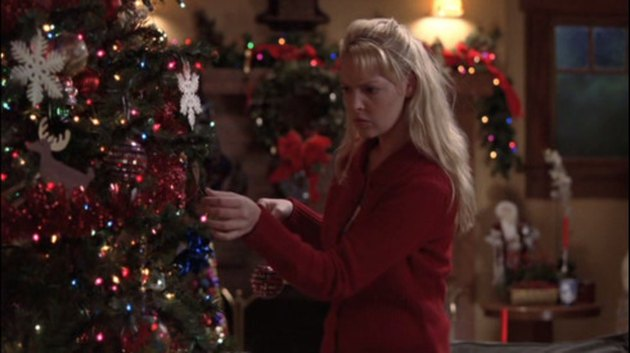 scene from Grey's Anatomy Christmas Special featuring a woman near Christmas tree