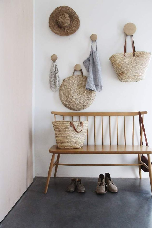minimalist hallway idea with wood bench and wall hooks