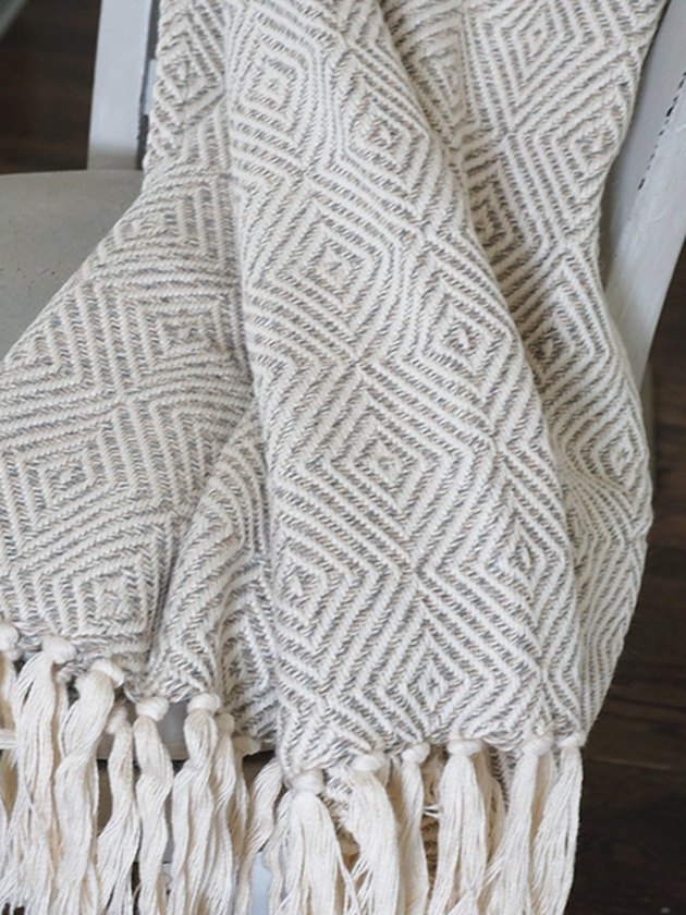 geometric-patterned knit throw in gray and white