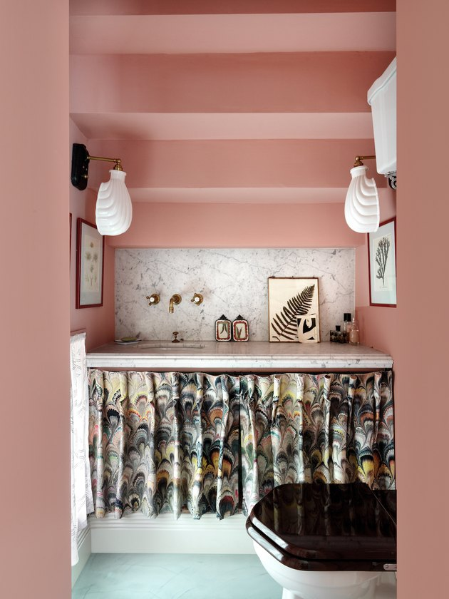 bathroom space with pink walls