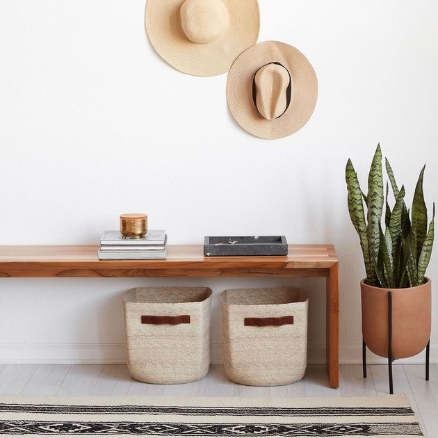 entryway with bench, plant, and baskets