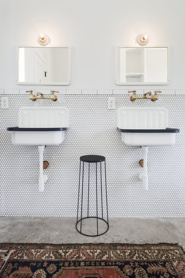 Utilitarian modern farmhouse bathroom with vintage sinks