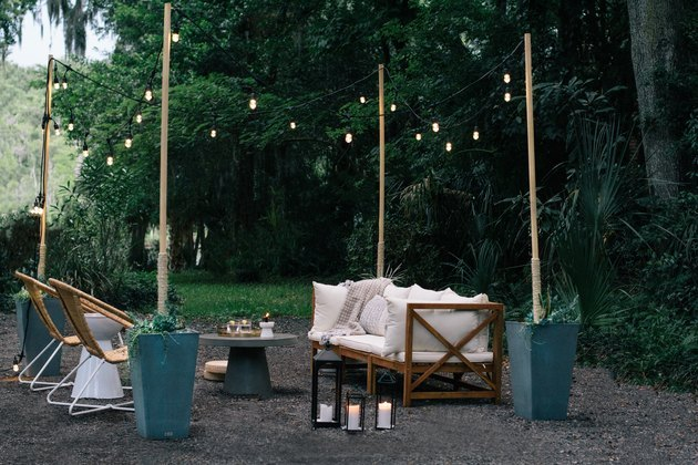 woodland garden with string fairy lights and lanterns