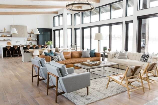 open floor layout with couches and high ceilings