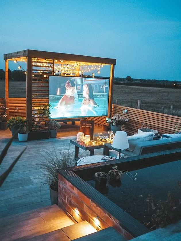 outdoor cinema with pergola and string lighting