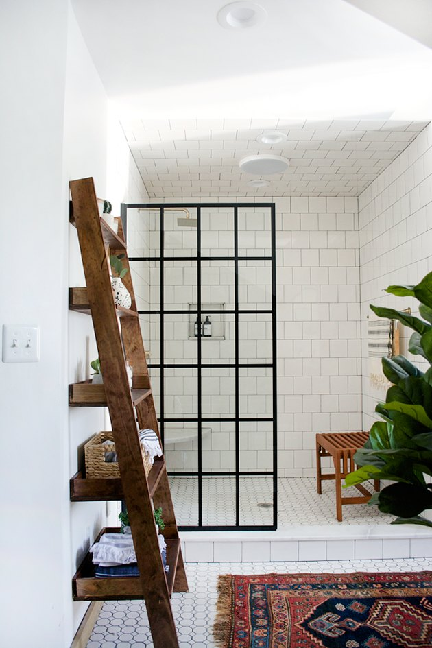 modern shower idea with iron window shower door with vintage rug and subway tile
