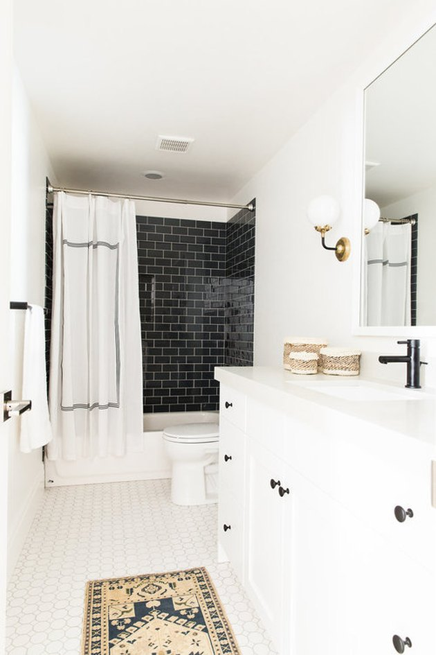 modern shower idea with black subway tile in modern white bathroom