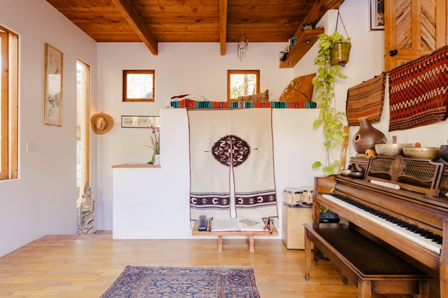 view of a piano and hardwood floors. Southwest design