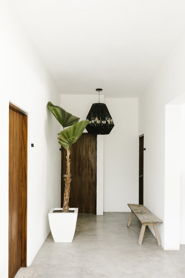 hallway idea with pendant light hanging and rustic bench