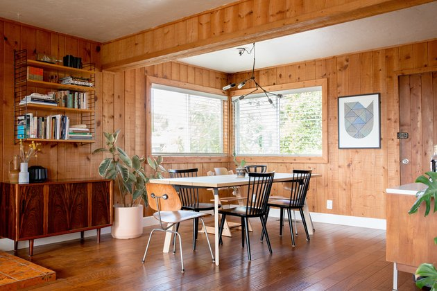 dining room with wood paneling and hardwood floors