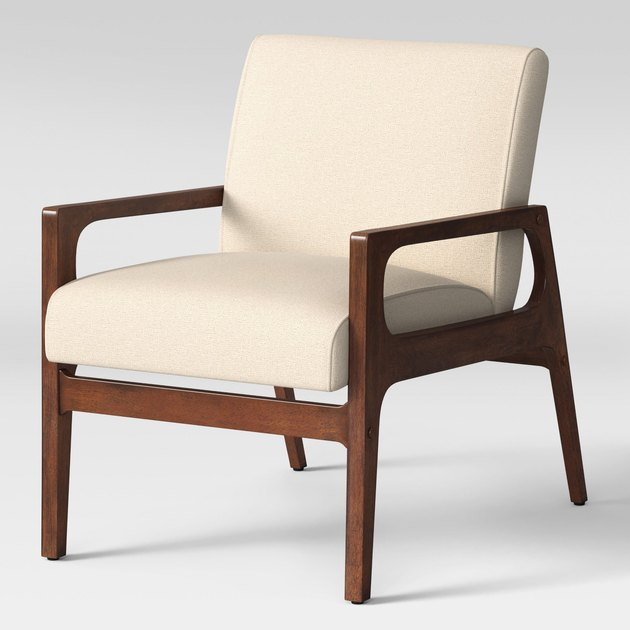 Cream arm chair with wooden base and arms in medium finish