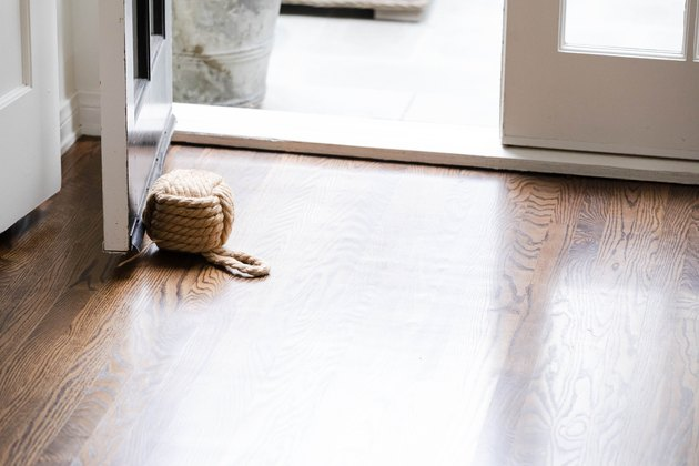 dark hardwood flooring in front of open door