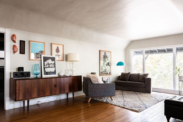 wood floor, living room, credenza and chairs