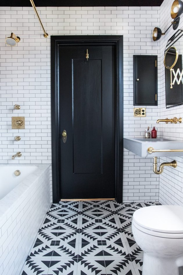 black and white bathroom with patterned floor tile