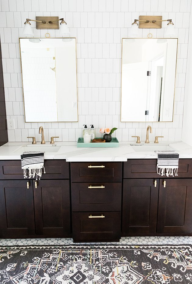 master bathroom with dark wood cabinets and his and hers sinks