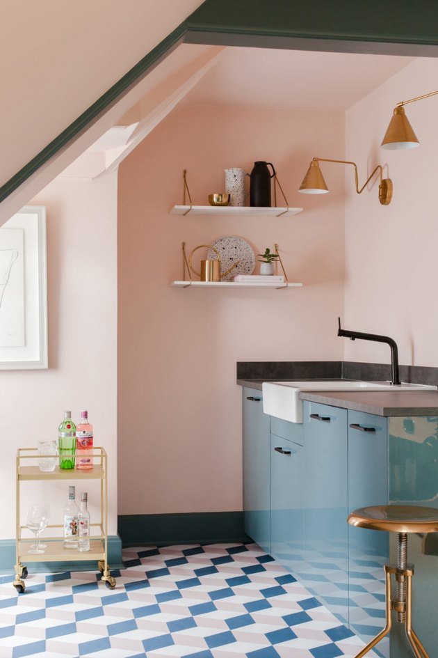 pink and blue kitchen floor tile with pink walls and blue cabinets