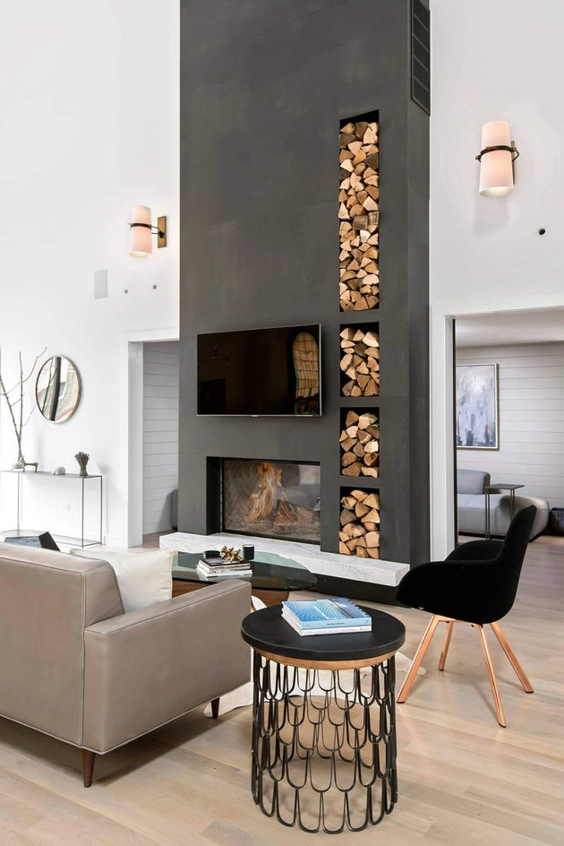 modern living room with two-sided gray fireplace
