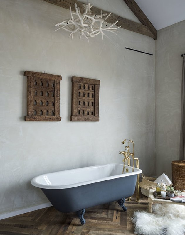 modern farmhouse bathroom with blue clawfoot bathtub