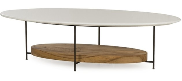 Oval coffee table with white top and lower oval wooden shelf