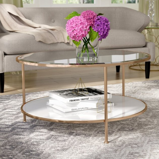 gold, marble, and mirror round coffee table